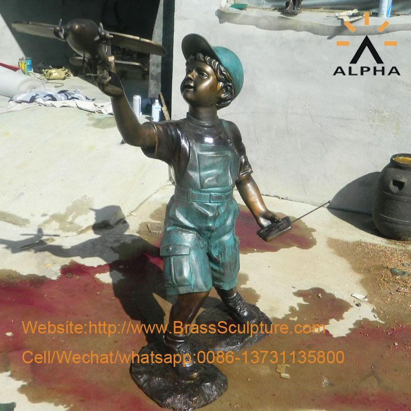 The bronze boy with airplane statue sculpture
